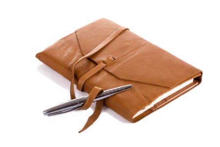 Horizontal image of a leather covered notebook and a silver pen with shadow against a 255 white background. Stock Photo - 10473866