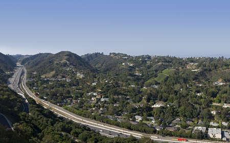 4 image stitch of the Los Angeles skyline with freeway  Stok Fotoğraf