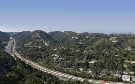 4 image stitch of the Los Angeles skyline with freeway  Stock Photo