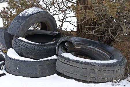 A pile of destroyed tires dumped on public lands, littering the landscape  photo