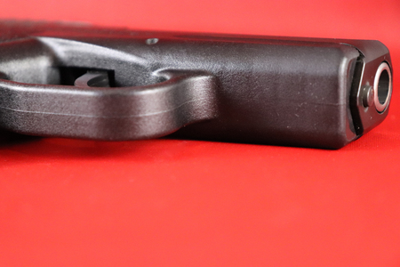 Closeup of isolated conceal carry pistol trigger guard and barrel Фото со стока