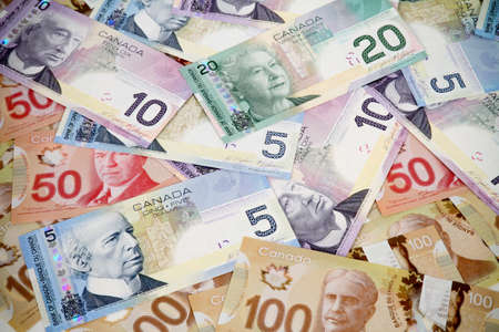 five dollar bill: Big pile of money. Canadian dollars Stock Photo