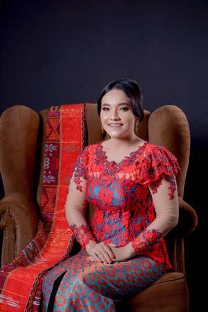 portrait of beautiful indonesian women wearing traditional batak costume isolated on black background. batak modern traditional clothes Banco de Imagens