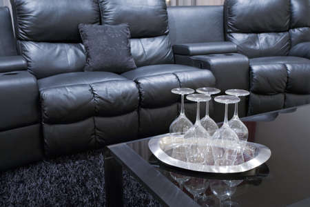 black executive leather home teather chairs with wine glasses on tray on black table Stock Photo - 6057363