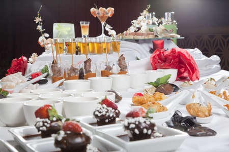 Asian Fusion appetizers and desserts on table Stock Photo - 6100158
