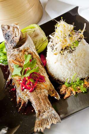barramundi: Australian Barramundi, served with fragrant Jasmine rice and wilted bok choy Stock Photo
