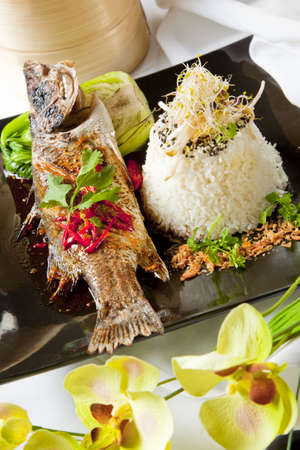 Australian Barramundi, served with fragrant Jasmine rice and wilted bok choy Stock Photo - 6100214