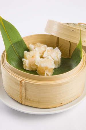 Dumplings in bamboo steamer photo