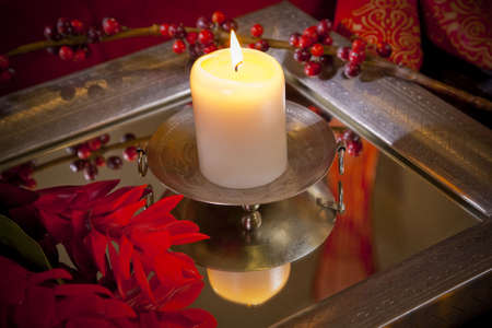 homeware: candle burning in moody Balinese interior setting