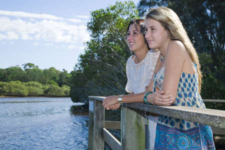 two girls looking out from  viewing platform by the creek photo