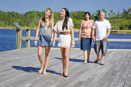 holiday spending: family walking on viewing platform by the creek