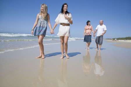 family walking on beach holding hands Stock Photo - 6151890