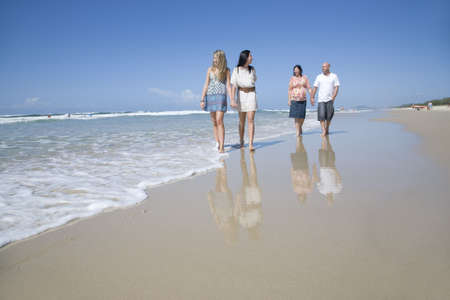 family walking on beach holding hands Stock Photo - 6151892