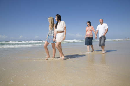 family walking on beach holding hands Stock Photo - 6151893