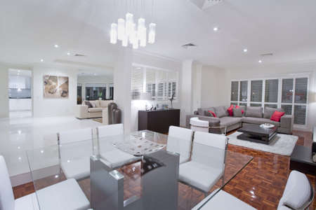 Luxurious dining room with living rooms and kitchen in the background photo