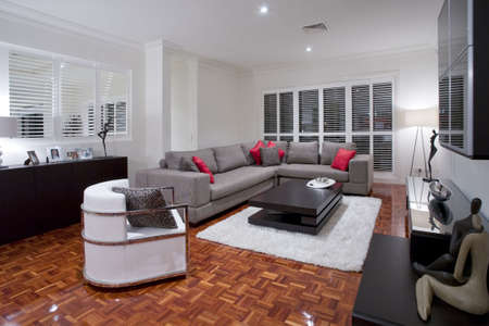showcase interiors: Luxurious living room with wooden flooring Stock Photo