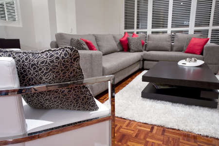 showcase interiors: modern living room interior with charcoal sofa and chocolate brown coffee table Stock Photo