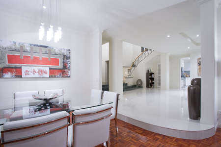overlooking: Luxury home dining room interior with overlooking staircase and hallway