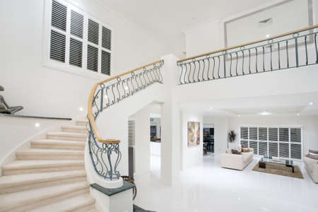entrance hall in luxury modern mansion photo