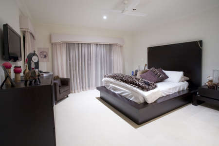 Girly bedroom in luxury mansion Stock Photo