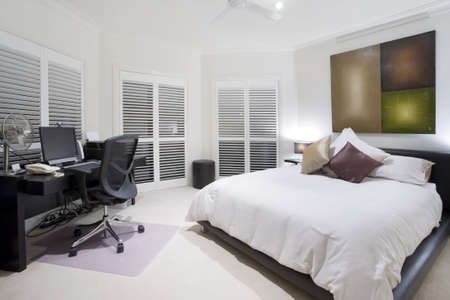 showcase interiors: Office and spare bedroom in luxury mansion