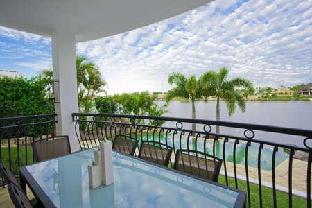 Balcony entertainment area of waterfront house Stock Photo