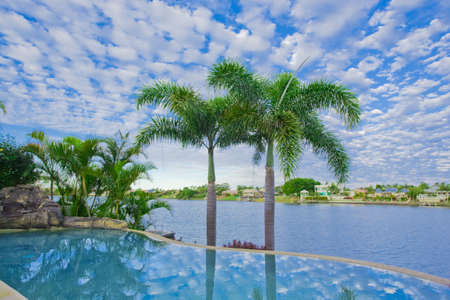 waterfront property: Infinity Pool with Views over canal