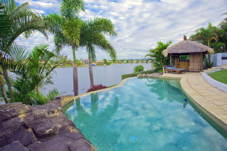 Waterfront Mansion with Pool and Bali hut overlooking the canal Stock Photo - 6151989