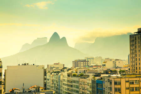 view over tops of residential buildings and mountains in Ipanema Rio de Janeiro Brazil photo
