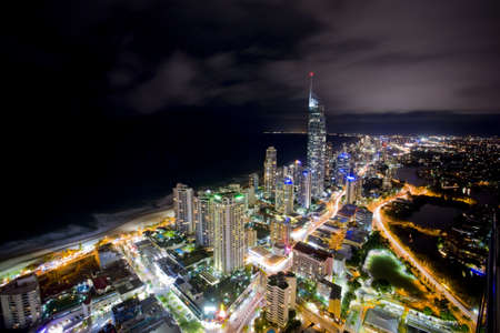 night scene of the gold coast with q1 in the background