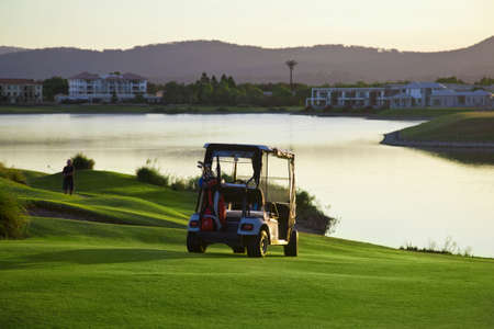 clear day: Golf Course and buggies