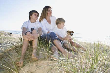 Family sitting on the beach photo