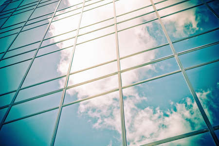 modern corporate glass building with cloud reflections in glass photo