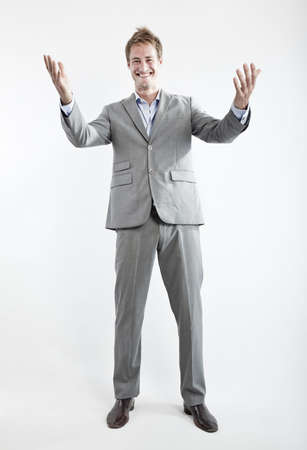 business man in grey suit on white background in studio Stock Photo - 6550359