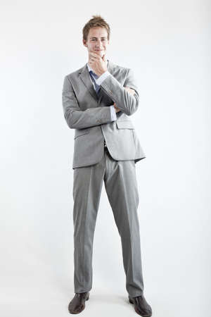 business man in grey suit on white background in studio Stock Photo - 6550354
