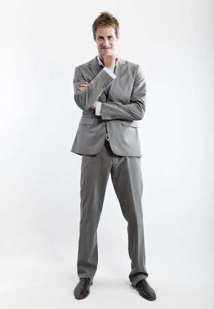 business man in grey suit on white background in studio photo