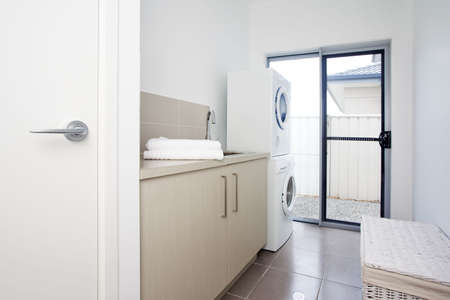 man laundry: laundry room in modern townhouse
