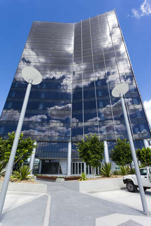 Modern Corporate Building with sky and clouds reflecting Stock Photo - 9495649