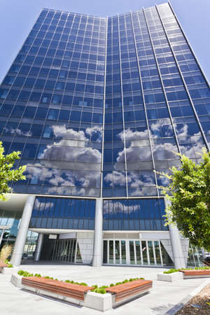 Modern Corporate Building with sky and clouds reflecting photo