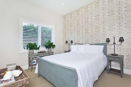 queen bed: Stylish guest bedroom with queen bed
