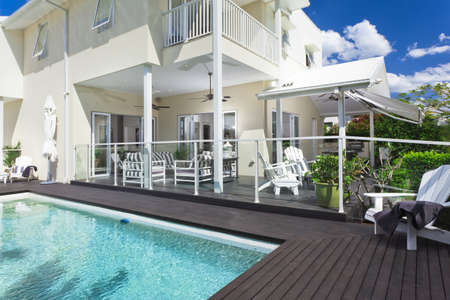 pool deck: Stylish swimming pool with covered outdoor entertaining area