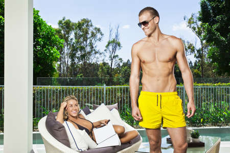 Attractive young couple in backyard patio photo