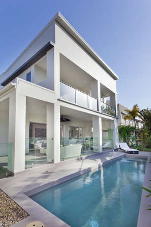 Stylish new house with covered patio and swimming pool photo