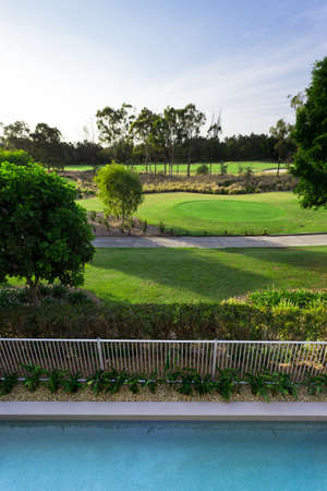 Golf course and swimming pool view from balcony Stock Photo - 13909659