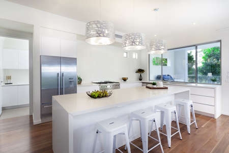 modern kitchen domestic home house: Stylish open plan kitchen overlooking the backyard Stock Photo