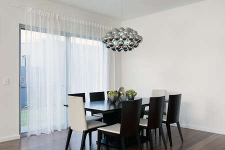 Stylish area with table and chairs photo