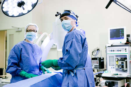 Surgeon and nurse in operating theatre Stock Photo - 13909644