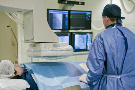 cardiac: Cathlab in modern hospital with doctor and patient