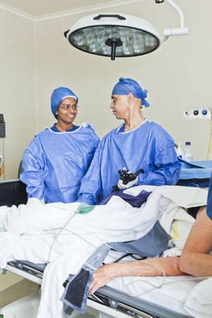 Surgery with operating table, nurse and surgeon Stock Photo - 13909524