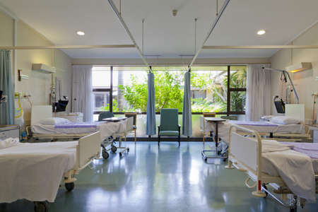 sickroom: Hospital ward with beds and medical equipment